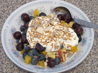 Fresh fruit and yoghurt with nuts and seeds